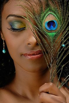 peacock makeup...how much fun could you have with this! I might even try it tom.! I have all those colors!