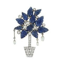 White Gold, Carved Sapphire and Diamond Brooch 11 carved sapphire leaves, 9 round rose-cut diamonds, 3 diamond briolettes, 27 round diamonds ap. .65 ct., ap. 9.4 dwt.♥≻★≺♥