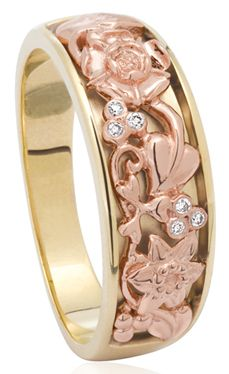 Limited edition Jubilee Celebration ring / Adorning the ring are the iconic flowers of the four countries of Great Britain: the Welsh Daffodil, English Rose, Irish Shamrock and Scottish Thistle, crafted in beautiful 9ct yellow and rose gold.