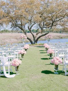 Outdoor ceremony at The DeBordieu Club featuring pink rose/peony aisle decor. Floral – Blossoms Events | Day-of Coordination – Stunning and Brilliant Events | photography by http://www.pashabelman.com