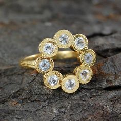 gold and white topaz rosette ring by embers   notonthehighstreet.com