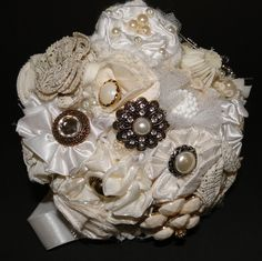 Fabulous bouquet of fabric flowers and antique buttons.