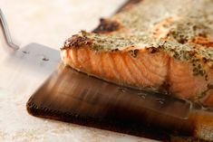 Cedar-Planked Salmon with Herbed Yogurt Sauce - Serve this broiled salmon recipe with a chive-tarragon yogurt sauce for a special brunch.