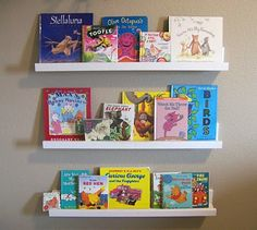 homemade book shelf ledges for only $20.  Looks pretty easy to make with wood, wood glue, and nails!
