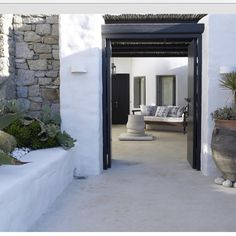 """~Mykonos~  Love all the textures and the neutral earthy colours.  #pinterest #mykonos #stone #succulents #black #white #love #outdoorliving #textures"""
