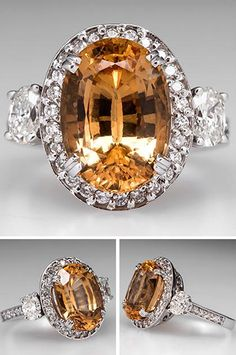 HESSONITE GARNET COCKTAIL RING W/ DIAMOND ACCENTS 14K WHITE GOLD. This stunning hessonite garnet cocktail ring is centered with a large 7.2 carat orangy yellow garnet. The garnet is surrounded by a halo of round brilliant cut diamonds atop a highly pierced floral gallery. Set into each shoulder is an oval cut diamond accent with round brilliant accents running down the shoulders. This estate cocktail ring is crafted of solid 14k white gold