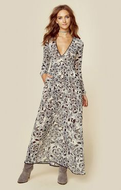 """For Love and Lemons' Gracie Maxi Dress oozes romance with its pretty cream floral print throughout, plunging neckline, pom pom trim, and long balloon sleeves. This item runs large; size down for the perfect fit.   ImportedDry Clean OnlyPoly Chiffon BlendFit Guide:Model is 5ft 7 inches; Bust: 32"""", Waist: 24"""", Hips: 34""""Model is wearing a size XSRelaxed FitShoes Featured Not Available For Purchase"""
