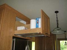 What do you think the best use of the space over the refrigerator is? Regular cabinets seem to end up as black holes for me. In our first kitchen we put in a very small, short refrigerator because of space constraints and I put a pot rack over it--it was great for us. I have also seen dividers for c...