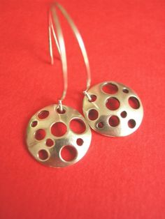 'Swiss Cheese' earings... strange that I like these even if I'm not a cheese girl?