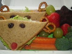 Lunchalicious - This lunch is: Christmas themed lunch with Rudolf sandwich, reindeer carrot sticks, broccoli Christmas trees, red/green fruit and a snowflake shaped Yummylicious brownie. Fun, Healthy, Local, Organic & delicious!