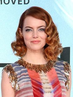 Emma Stone The Amazing Spider-Man 2 red carpet beauty look: blue eyeshadow, soft coral lipstick and vintage curls | allure.com