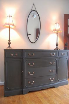 Gorgeous antique buffet, painted in Annie Sloan's Graphite chalk paint with dark wax. Copper pulls pop against this color, don't you think?! ♥ Discover the hottest designs and inspirations on Buffets and Cabinets | Visit us at http://www.buffetsandcabinets.com/ | #buffetsandcabinets #designnews #designinspiration #celebratedesign #interiordesign #designlovers #designbook #furnituredesign #luxuxryfurniture #interiordesigninspiration
