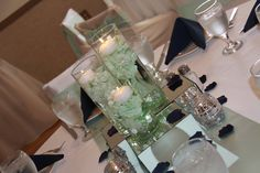 Beautiful wedding centerpieces with mint tinted water