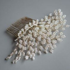Pearls Tree Handmade Headpiece Gold Bridal Hair Comb. As its name, this handmade bridal headpiece features twigs made of numerous little round pearls, as if a pearl tree. This unique gold wedding comb has shown the high level of wiring technique and perseverance of the crafter in achieving the sheering details of each small branch. This hair accessory is perfect as prom and bridal jewelry which adorns a wide range of wedding hairstyles.