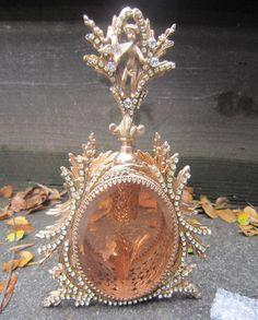 1o2 Vintage Vanity JEWELED Gilt Perfume Bottle Matson beveled peach glass cherub