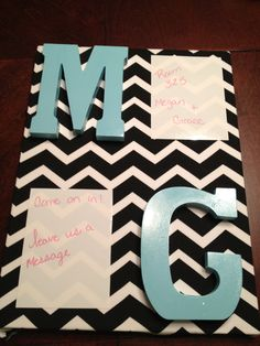 Dorm door decoration! Our initials and whiteboards for messages!