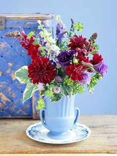 A classic mixed-flower arrangement doesn't have to be difficult to create. Achieve a professional-looking bouquet when you use your intuition and our easy instructions. Try these flower arrangement ideas to create your own gorgeous bouquets at home. Dark Flowers, My Flower, Fresh Flowers, Flower Power, Beautiful Flowers, Flower Vases, Colorful Flowers, Beautiful Flower Arrangements, Floral Arrangements