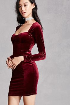 This stretch-knit velvet mini dress features a square-cut neckline, a padded bust, long sleeves, and a concealed back zipper. This is an independent brand and not a Forever 21 branded item.