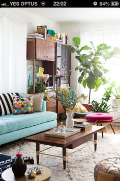 I Like the green plants, the colour of the lounge and the eclectic feel of this room