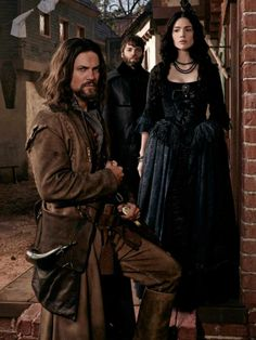 Salem. Mary Sibley, John Alden, and in back Cotton Mather. Love this show.