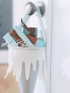 Make an extra-large cone to hang on a doorknob and hold wrapped gifts for friends. Form the cone from a large sheet of card stock, taped together. Decorate the top edge of the cone with white paper cut to resemble icicles or melting snow. Blue Christmas, Christmas Paper, Christmas 2014, Holiday Fun, Holiday Crafts, Wrapped Gifts, Snowflake Craft, Paper Cones, Christmas Living Rooms