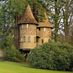 A tree house that looks like a stone castle.