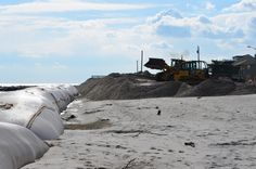 Geo Tubes Exposed from Hurricane Sandy, John Deere 700j Crawler Dozer working with a CAT 950F Wheel Loader to set up a sand barrier between the beach and the road.