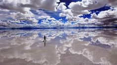 Salar de Uyuni, Bolivia: Salar de Uyuni might be considered the world's largest mirror. Stretching nearly 11k sqkm across central Bolivia, it is the world's biggest salt flat. After the rain falls and the water has settled, the ground at Salar de Uyuni reflects a perfectly clear image of the sky above. These salt flats lie at the top of the Andes, at an elevation of 3650m. The area also holds half the world's supply of lithium.