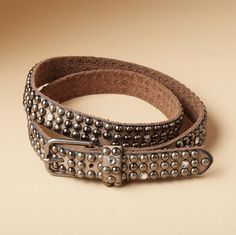 Sundance Catalog's METAL 'N' SPARKLE BELT--Must-have skinny belt in taupe vegetable-tanned leather, paved with metal studs and random rhinestones. Antiqued nickel buckle.