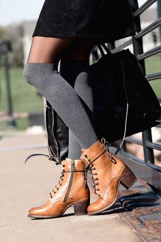 Tan lace up booties by BEDSTU. Style it with long thigh high socks and stay extra cozy.
