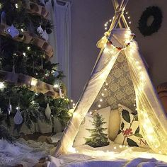 "I adore this Christmas tepee that @ourvintagefarmhouse made for her daughter! I showed this picture to my kids and my youngest daughter said, ""it's magical mom!"" More Christmas inspiration @ourvintagefarmhouse. Photo credit: @ourvintagefarmhouse"