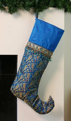one of a kind fantasy christmas stocking in blue silks with gold and