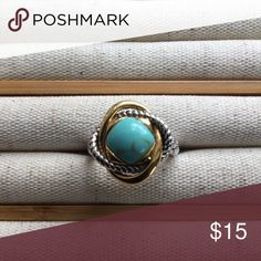 Turquoise ring Perfect ring for summer outfits. Beautiful turquoise color with gold and silver trim. Size 7 Jewelry Rings