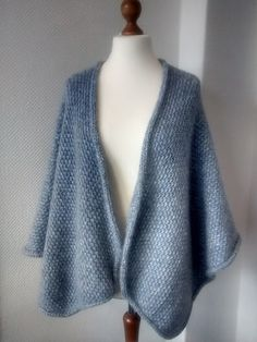http://www.ravelry.com/patterns/library/flugel-cape---winged-cape