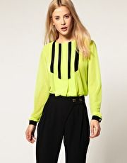 neon blouse with pleats.