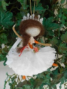 Adorable Poseable White Carnation Petal Pixie Faerie Doll Ornament One of a Kind  Measures: 6 Tall x 6 Wide  Colors are: White, Orange and she has Brown Wool Hair  Pearl Bead Tiara Also Makes a Great Pocket Doll - Wonderful to add on a Wrapped or Shopping Bagged Gift - Party Favors - Fun To Collect  One of a Kind - By: Willow Bloome  http://ave21.com/  Use Coupon Code: Holiday10