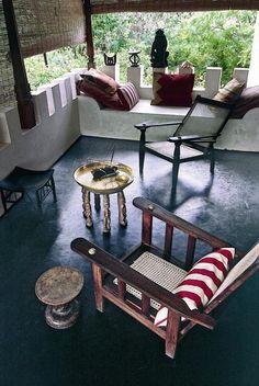 dark floor + matchstick blinds (Marie-Paule Pelle's home on Lamu Island in Kenya)