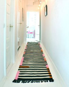 Need to do something with my long hallway! It is so long and hard, I need to get a soft, cushion-y, but chic rug.