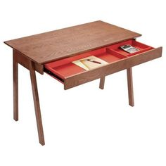We love the colorful surprise in this Caché Desk,it's the perfect compliment to the walnut color. With its clean lines and that roomy drawer, this desk is a stylish steal. $239 at The Container Store.
