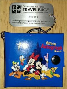 K8B083 - This is a little autograph book from Walt Disney World and full of characters' signatures. But no room for yours, so if you discover this bug, please be sure to list your favorite Disney character in your log entry!  Thanks!