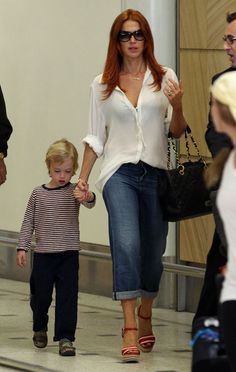'Unforgettable' star Poppy Montgomery and her adorable little guy, Jackson Kaufman, arrive in Sydney, Australia on April 14th, 2012.