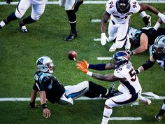SI's Best Photos From Super Bowl 50 - Von Miller stripped sacked Cam Newton on this play, leading to a touchdown.