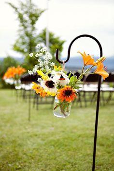 beautiful flowers hung from a shepherds hook