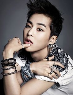 "Xiumin modeling for Swarvoski's new bracelet line ""Stardust.""yeah...im just loocking at the bracelet"