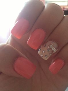 Pink acrylics with cream accent nail and rhinestone bow. ❤