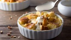 Is there anything more comforting than a warm bowl of bread pudding? Our Banana Chocolate Chip Bread Pudding is not only tasty, but it's also a great way to use up stale bread and bananas that are a bit past their prime. Chocolate Chip Bread Pudding, Brioche Bread Pudding, Bread Pudding With Apples, Bread Puddings, Pudding Recipes, Dessert Recipes, Pudding Desserts, Pudding In A Mug, Crock Pot Bread