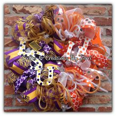 LSU & University of Texas house divided football wreath. More wreaths can be found on my Facebook page: www.facebook.com/CraftsandCreationsByTerri or go to my Etsy page https://www.etsy.com/shop/CreatedByTerri