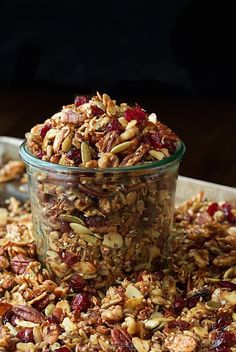 Photo of a pan of Paleo Granola with a Weck jar overflowing with the granola in the middle of the pan.