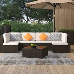 Longshore Tides Breccan Patio Furniture on Clearance 7 Piece Rattan Sectional Seating Group with Cushions & Reviews | Wayfair