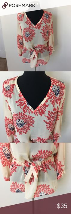 "Banana Republic Sheer Floral Print Blouse Banana Republic Sheer Floral print blouse. Vneck. Cinched at waist. 100% polyester. Size small. Underarm to Underarm: 19"". Top to bottom: 27.5"". Banana Republic Tops Blouses"